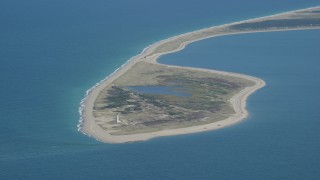 AX144_067 - 6K stock footage aerial video flying by Great Point Light, island, Nantucket, Massachusetts