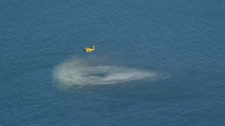 AX144_070 - 6K stock footage aerial video flying by a Coast Guard helicopter conducting rescue practice, Atlantic Ocean