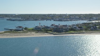 AX144_075 - 6K stock footage aerial video flying by small island town, Nantucket Harbor Range Lights, Nantucket, Massachusetts