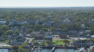 AX144_077 - 6K stock footage aerial video of a coastal community, Unitarian Universalist Church, Nantucket, Massachusetts