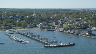 AX144_079 - 6K stock footage aerial video flying by coastal community, piers, Nantucket, Massachusetts