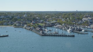 AX144_080 - 6K stock footage aerial video flying by coastal community, piers, Nantucket, Massachusetts