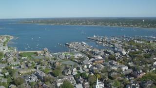 AX144_085 - 6K stock footage aerial video orbiting small coastal town, Nantucket Harbor, Nantucket, Massachusetts