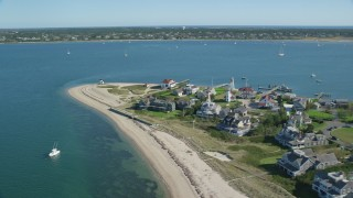 AX144_088 - 6K stock footage aerial video flying by oceanfront homes, Nantucket Harbor Lights, Nantucket, Massachusetts