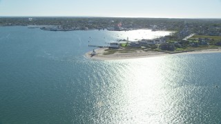 AX144_089 - 6K stock footage aerial video flying by oceanfront homes, Nantucket Harbor Range Lights, Nantucket, Massachusetts