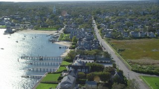 AX144_091 - 6K stock footage aerial video flying over small island town, oceanfront homes, Nantucket, Massachusetts