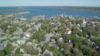 AX144_095 - 6K stock footage aerial video flying by small coastal community, Nantucket Harbor, Nantucket, Massachusetts