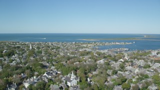 AX144_096 - 6K stock footage aerial video flying by small coastal community, Nantucket Harbor, Nantucket, Massachusetts