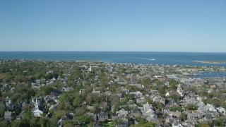 AX144_097 - 6K stock footage aerial video flying by small coastal community, Nantucket Harbor, Nantucket, Massachusetts