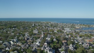 AX144_098 - 6K stock footage aerial video of a small coastal community, reveal Nantucket Harbor, Nantucket, Massachusetts