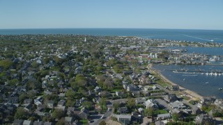 AX144_099 - 6K stock footage aerial video flying over small coastal community near the harbor, Nantucket, Massachusetts