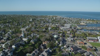 AX144_100 - 6K stock footage aerial video flying over small coastal community near the harbor, Nantucket, Massachusetts