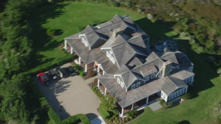 AX144_114 - 6K stock footage aerial video approaching upscale home, then fly away over trees, Nantucket, Massachusetts