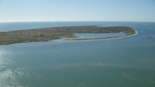 AX144_116 - 6K stock footage aerial video flying over the ocean, approaching Tuckernuck Island, Nantucket, Massachusetts