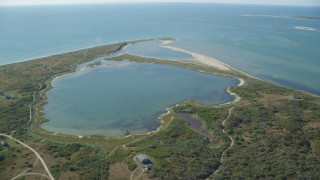 AX144_119 - 6K stock footage aerial video approaching North Pond, Tuckernuck Island, Nantucket, Massachusetts