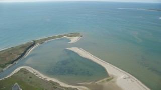 AX144_120 - 6K stock footage aerial video flying over North Pond, beach, Tuckernuck Island, Nantucket, Massachusetts