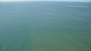 AX144_121 - 6K stock footage aerial video flying out over Atlantic Ocean from Tuckernuck Island, Nantucket, Massachusetts