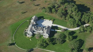AX144_129 - 6K stock footage aerial video of a bird's eye view, isolated mansion, Chappaquiddick Island, Martha's Vineyard, Massachusetts