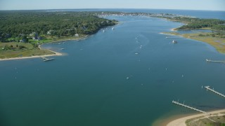AX144_130 - 6K stock footage aerial video flying over Katama Bay, Edgartown, Martha's Vineyard, Massachusetts