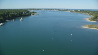 AX144_131 - 6K stock footage aerial video flying low over Katama Bay, Edgartown, Martha's Vineyard, Massachusetts