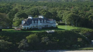 AX144_132 - 6K stock footage aerial video flying by waterfront mansion, Edgartown, Martha's Vineyard, Massachusetts