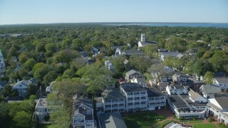 AX144_135 - 6K stock footage aerial video flying over boats, small coastal town, Edgartown, Martha's Vineyard, Massachusetts
