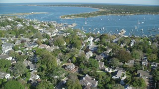 AX144_138 - 6K stock footage aerial video orbiting small coastal town, Edgartown, Martha's Vineyard, Massachusetts