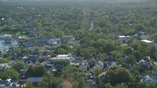 AX144_143 - 6K stock footage aerial video flying by small coastal town, Edgartown, Martha's Vineyard, Massachusetts
