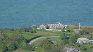 AX144_145 - 6K stock footage aerial video flying by oceanfront home, Edgartown, Martha's Vineyard, Massachusetts