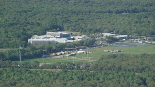 AX144_151 - 6K stock footage aerial video of Martha's Vineyard Regional High School, Edgartown, Martha's Vineyard, Massachusetts