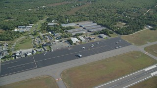 AX144_153 - 6K stock footage aerial video flying by Martha's Vineyard Airport, West Tisbury, Massachusetts