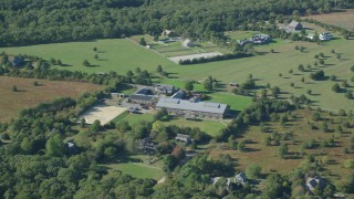 AX144_154 - 6K stock footage aerial video flying by mansion, West Tisbury, Martha's Vineyard, Massachusetts