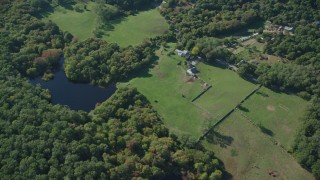 AX144_157 - 6K stock footage aerial video of a bird's eye view, rural homes, ponds, West Tisbury, Martha's Vineyard, Massachusetts