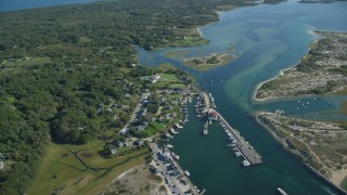 AX144_160 - 6K stock footage aerial video flying by Menemsha Pond, Chilmark, Martha's Vineyard, Massachusetts