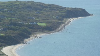 AX144_161 - 6K stock footage aerial video flying by beachfront homes, Aquinnah, Martha's Vineyard, Massachusetts