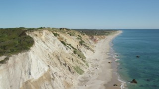 AX144_164 - 6K aerial stock footage video flying by coastal cliffs, reveal homes, Aquinnah, Martha's Vineyard, Massachusetts
