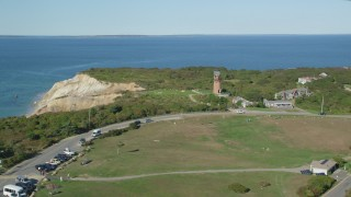 AX144_165 - 6K stock footage aerial video flying by Gay Head Light, coastal cliff, Aquinnah, Martha's Vineyard, Massachusetts