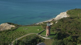 AX144_166 - 6K stock footage aerial video flying by Gay Head Light, Aquinnah, Martha's Vineyard, Massachusetts