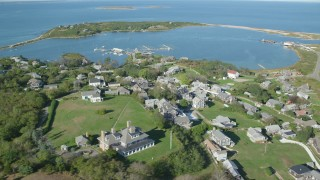 AX144_176 - 6K stock footage aerial video of a coastal community near pond, Cuttyhunk Island, Elisabeth Islands, Massachusetts