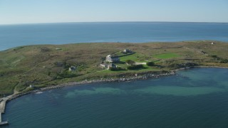 AX144_180 - 6k stock footage aerial video of Pekinese Island School, Penikese Island, Elisabeth Islands, Massachusetts
