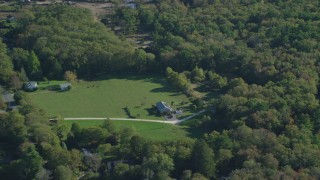 AX144_214 - 6k stock footage aerial video flying by rural homes, lawns, trees, Dartmouth, Massachusetts