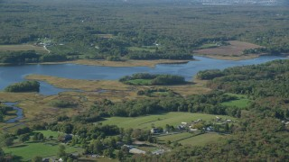 AX144_215 - 6k stock footage aerial video flying by river and marshland, Westport, Massachusetts