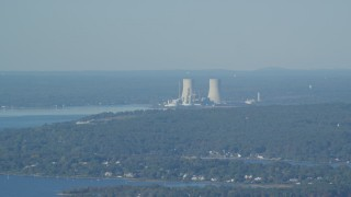 AX144_222 - 6k stock footage aerial video flying by Dynegy Brayton Point coal-fired power plant, Somerset, Massachusetts