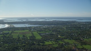 AX144_224 - 6k stock footage aerial video approaching coastal community, Middletown, Rhode Island