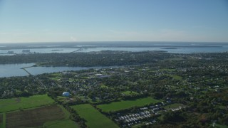 AX144_225 - 6k stock footage aerial video approaching coastal community, Middletown, Rhode Island