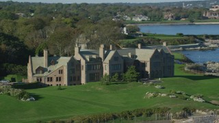 AX144_253 - 6k stock footage aerial video flying by Rough Point, oceanfront mansion, rocky coast, Newport, Rhode Island