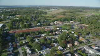AX144_263 - 6k stock footage aerial video flying over neighborhoods, approach Newport State Airport, Middletown, Rhode Island
