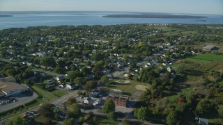 AX145_001 - 6k stock footage aerial video flying by a coastal community, Middletown, Rhode Island