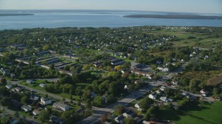 AX145_002 - 6k stock footage aerial video flying by a coastal community, ocean, Middletown, Rhode Island