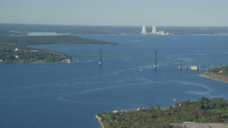 AX145_009 - 6k stock footage aerial video flying by Mount Hope Bridge, Dynegy Brayton Point, Portsmouth, Rhode Island